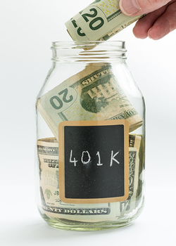 Image of person putting money in a jar that's labeled 401k